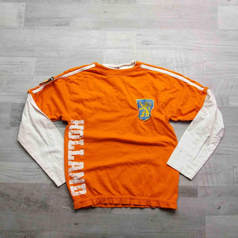 48267d483a5 tričko dl.rukáv oranžové s logem a nápisy vel 152