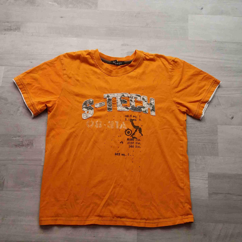b4732bc1f4a tričko kr.rukáv oranžové s nápisem GEORGE vel 152