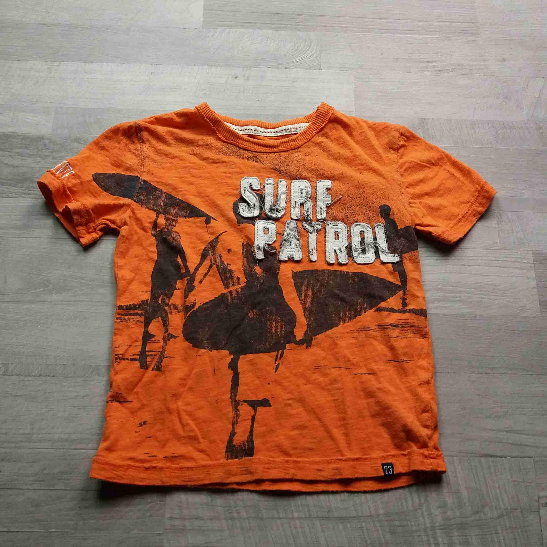 6d8a56fa9a1 tričko kr.rukáv oranžové s obrázkem CHEROKEE vel 116